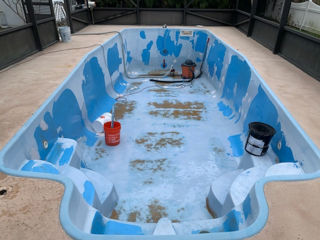 Florida Swimming Pool Resurfaces pre painting.