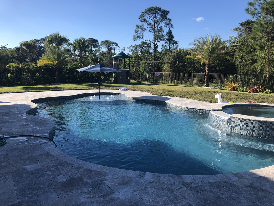 Aruba Swimming Pool Resurfaced and Pavers Installed by Aquatic Surfaces